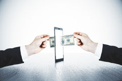 Money transfer with man hands and digital tablet concept Stock Photos