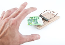 Money trap. Hand reaching for 100 euro bill. Isolated on white background Stock Image
