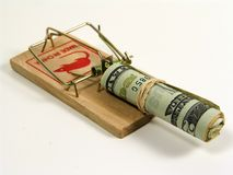 Money Trap. Photo of a Mouse Trap With a Roll of Money as Bait Royalty Free Stock Images