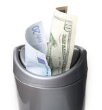 Money in trash bin Royalty Free Stock Photo