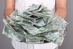 Money on the tray. Man with a tray full of Polish money Royalty Free Stock Image