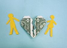 Money trouble. Paper couple and broken dollar heart - divorce or money trouble concept Royalty Free Stock Photos