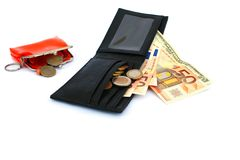 Money in two wallets Royalty Free Stock Photos