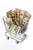 Money U.S. dollars with shopping basket. Currency U.S. dollar banknotes in a basket Stock Photos