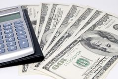 Money under a calculator Royalty Free Stock Photography