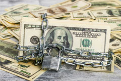 Money under lock and key. Stock Photos
