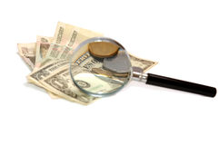 Money under a magnifier on the white. Money under a magnifier on white royalty free stock image