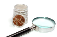 Money under a magnifier on the white. Money under a magnifier on white stock images