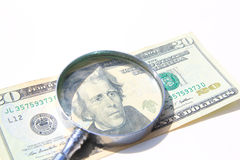 Money under magnify glass isolated Stock Image