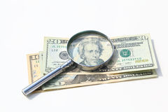 Money under magnify glass isolated Stock Photography