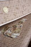 Money under the mattress Stock Image