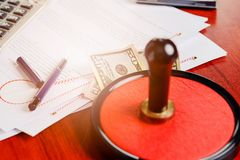 Money under the notary public stamper. Royalty Free Stock Photography