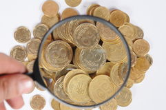 Money under a supervision Royalty Free Stock Photo