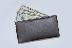 Money under wallet Royalty Free Stock Images