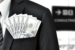 Money - United States dollar (or USD) bills in businessman pocket Royalty Free Stock Photo
