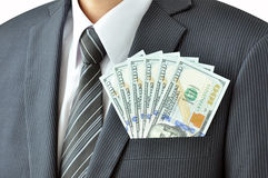Money - United States dollar (USD) bills in businessman pocket Royalty Free Stock Image