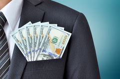 Money - United States dollar (USD) bills in businessman pocket Stock Image
