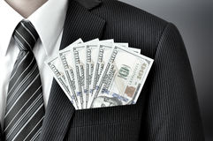 Money - United States dollar (or USD) bills in businessman suit pocket Royalty Free Stock Image