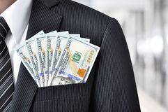 Money - US dollar bills in businessman suit pocket Royalty Free Stock Photos