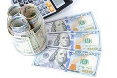 Money, US dollar bills, with calculator on the table Stock Photos