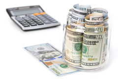 Money, US dollar bills, with calculator on white table Stock Photo