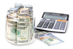Money, US dollar bills, with calculator on white table Stock Image