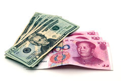Money - US dollars and Chinese Yuans. US 20-dollar bills and Chinese 100-yuan bills Royalty Free Stock Photo