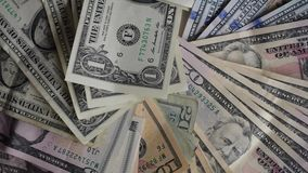 Money. USA currency notes, dollars of every kind close-up. Starts with a one dollar bill stock video footage