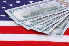 Money on USA flag Royalty Free Stock Photo