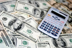 Money, USD. Dollars and calculator royalty free stock photos