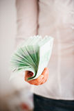 Money used as paper fan Stock Photo