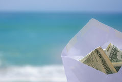 Money for vacation. White Envelop with money on the ocean phone Royalty Free Stock Photos