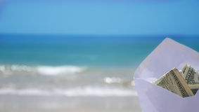 Money for vacation. White Envelope with money on the ocean phone Stock Photo