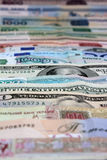 Money, various currencies as a background. Dollars, Euro, roubles Stock Photos