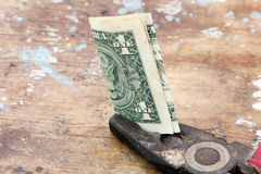 Money in vintage rustic plier Stock Image