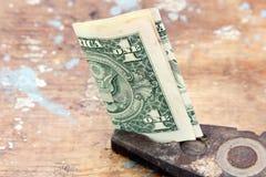 Money in vintage rustic plier Stock Photos