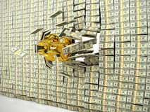 Money wall. Golden dollar sign breaking through the wall of money Stock Images