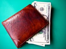 Money on a wallet Stock Photos
