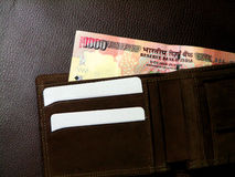 Money in wallet. Indian money in open brown, leather wallet Stock Photos