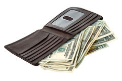 Money and Wallet. A wallet with American money spilling out royalty free stock photos