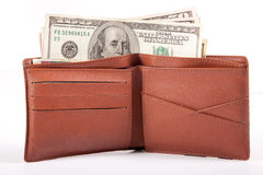 Money in Wallet. US dollar money in wallet, in white background Royalty Free Stock Images