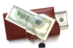 Money wallet. Some dollar in red wallet  on white background magnified Stock Photos