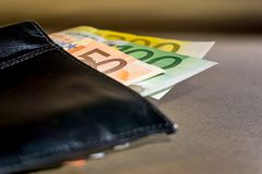 Money in a wallet. Euro bills in a wallet Royalty Free Stock Photography