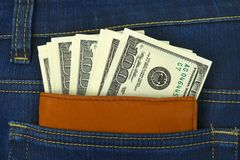 Money and wallet in jeans pocket Royalty Free Stock Images