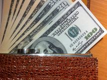 The money in wallet. Money in the wallet, a stack of dollars, paper money in the wallet royalty free stock photo