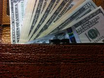 The money in wallet. Money in the wallet, a stack of dollars, paper money in the wallet stock photo