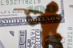 Money and war. Shadow of toy soldier on the background of dollar banknotes. Photo represents the economic causes of war Stock Photo