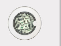 Money in washing machine Stock Image