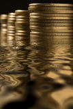 Money in water. With reflection over black Stock Images