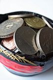 Money and Wealth. Asian coins in a miniature basket of wealth Royalty Free Stock Photography